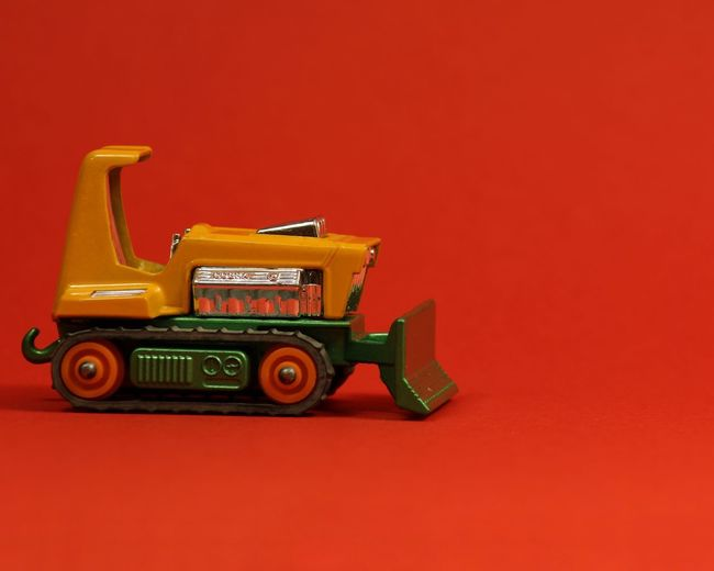 Toy car against red background