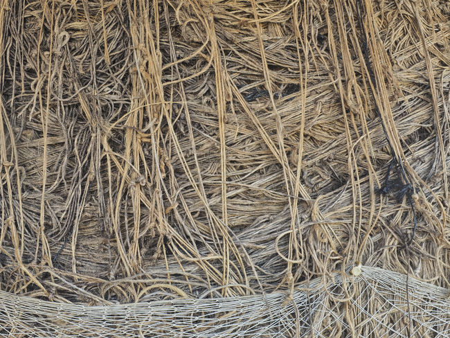 Closeup of a large ball of twine, with a piece of protected netting at the bottom. Backgrounds Bale  Ball Of Twine Brown Brown Color Close-up Cord Day Fiber Full Frame Hemp Jute Knots Netting No People Outdoors Strands Thread Twine Twine, Cord, Yarn, Thread, Strand, String