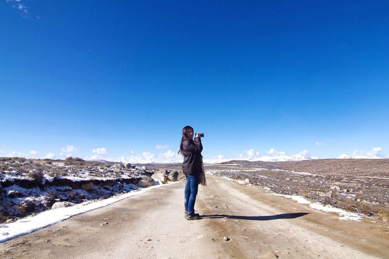 Girl in nature Amazing It's Cold Outside Snow ❄ Traveling China Nature Adventure Buddies World Mountains Landscape Blue Sky OpenEdit The Week Of Eyeem EyeEm Nature Lover Travel Photography Followme Live In The Moment Showcase March EyeEm Gallery Popular Girl Taking Photos Roadtrip