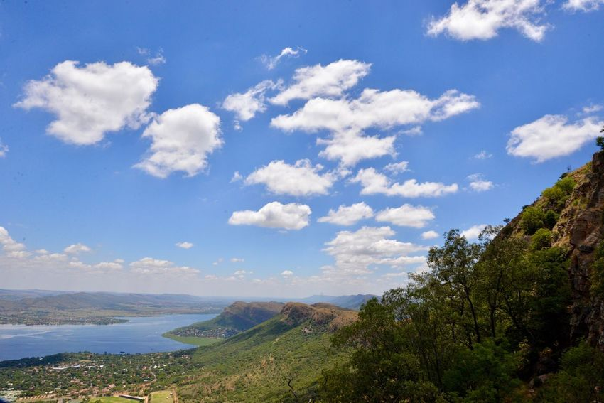 Hartbeespoort dam Hartbeespoort Dam Wall Cloud - Sky Scenics Sky Tranquil Scene Nature Tranquility Beauty In Nature Day Outdoors Blue No People Mountain Landscape Water Grass Tree Hartbeespoort Dam South Africa Harties Hartebeespoort Harties Travel Destinations