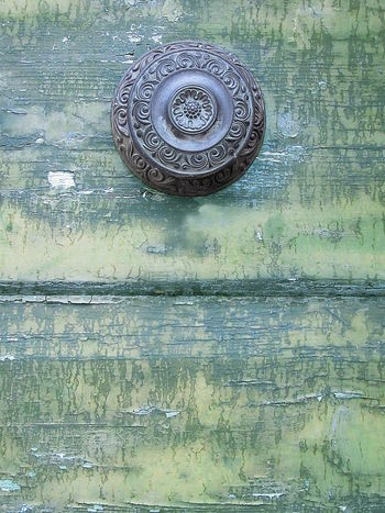 Old weathered wooden door detail with metal pommel ArchiTexture Blue Boards Close-up Copy Space Day Detail Door Green Knob No People Outdoors Pommel Textured  Textures And Surfaces Wooden