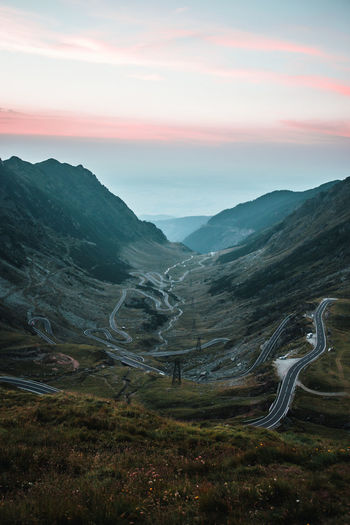 Romania Transfagarasan Pass Transfagaraşan Beauty In Nature Cloud - Sky Day Grass Landscape Mountain Mountain Range Mountain Road Nature No People Non-urban Scene Outdoors Range Road Scenics Sky Sunset Tranquil Scene Tranquility Transportation Travel Destinations Winding Road