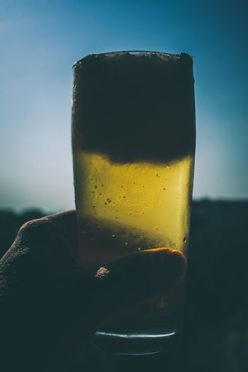 Close-up of a man holding a beer glass