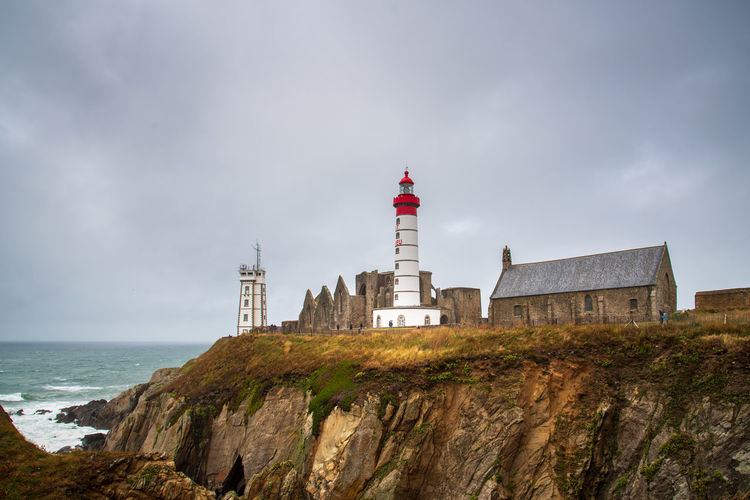 The lighhouse of Pointe Saint-Mathieu Architecture Built Structure Day Brittany France Europe Travel Sightseeing Sky Building Exterior Nature Outdoors Plougonvelin Building Tower Lighthouse Guidance No People Coast Cloudy Pointe Saint Mathieu Pointe Saint-Mathieu Maritime Coastal Sea Seascape Water Storm Cliffs Cloud - Sky History Land The Past Direction Protection Horizon Over Water