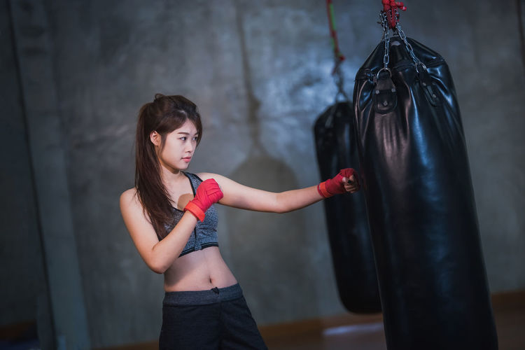 Female boxer punching bag