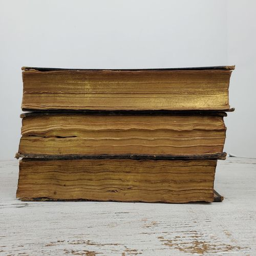 Close-up of books on table against white background