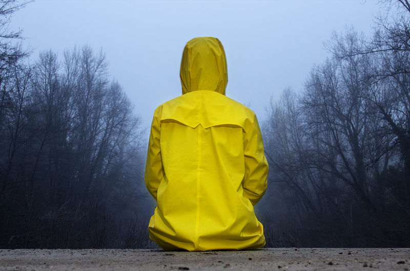 Rear view of man against yellow sky