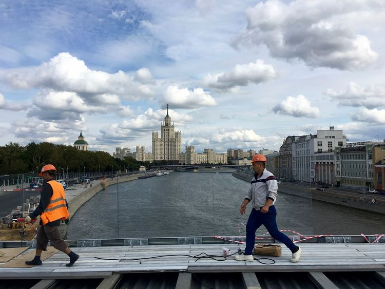 City Life Construction Moscow Workers Architecture Bridge - Man Made Structure Builders Building Exterior Built Structure City City View  Cityscape Cloud - Sky Construction Work Full Length Men Moscow Life Outdoors Real People Travel Destinations Water Business Stories Stories From The City