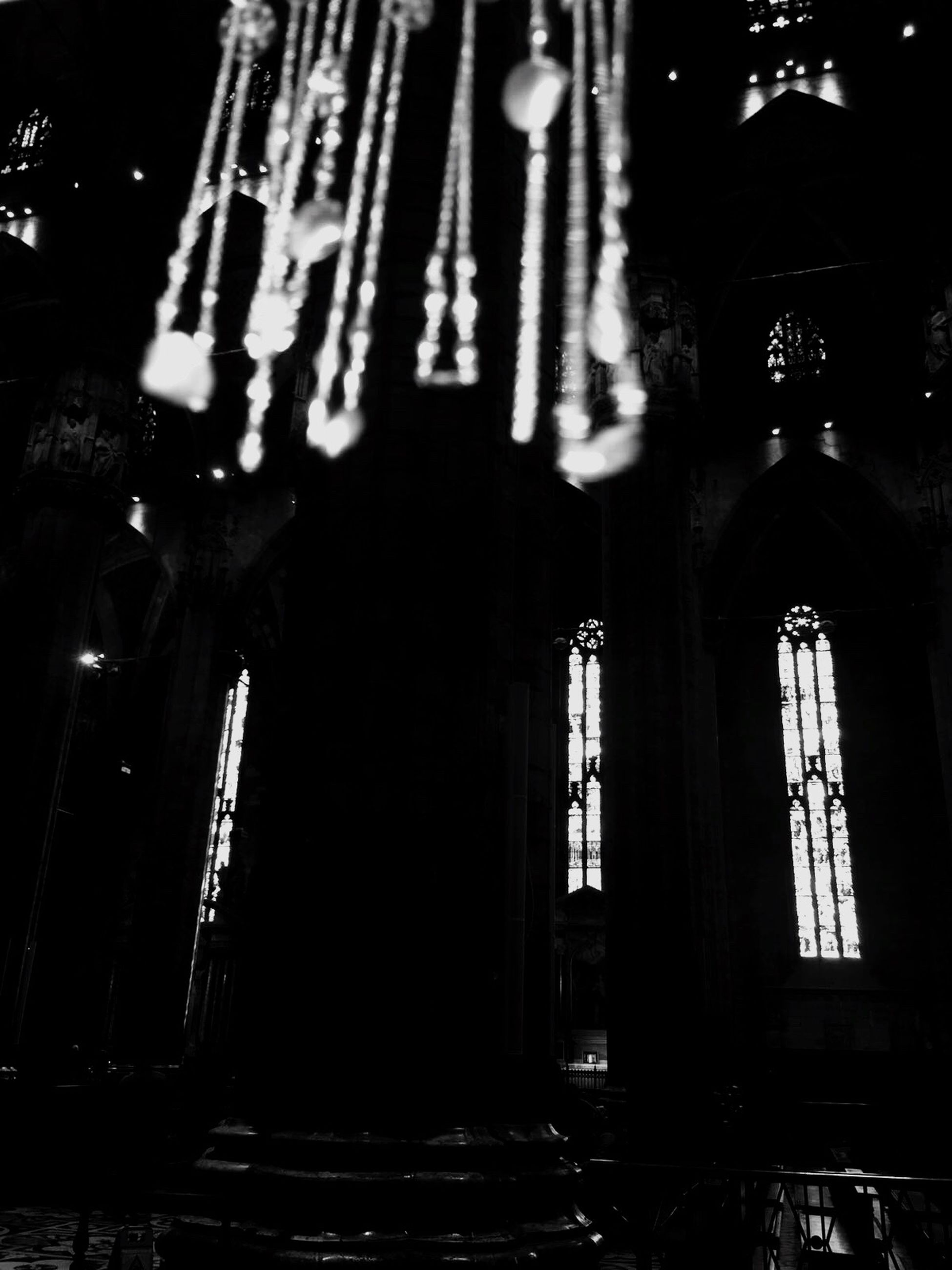 architecture, built structure, building exterior, night, illuminated, low angle view, religion, window, church, place of worship, indoors, spirituality, no people, house, glass - material, building, lighting equipment, old