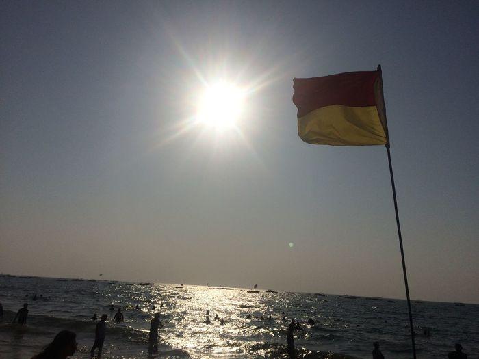 Karnataka Flag at Goa Sun Sunlight Sea Flag Sunbeam Lens Flare Sky Water Clear Sky Outdoors Nature Patriotism Beach Taking Photos
