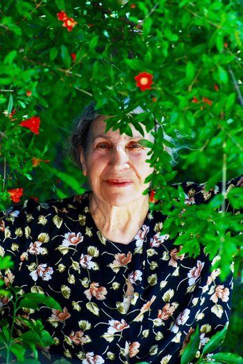 Portrait of senior woman by plants