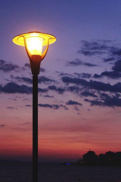 Sunset Illuminated Lighting Equipment Street Light Sky Dusk Nature Sea Cloud - Sky Beauty In Nature Sun No People Water Outdoors Yellow Scenics Horizon Over Water