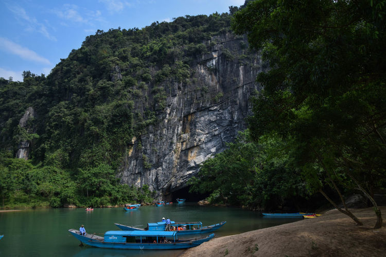 Phong Nha cave Tourist Attraction  Cave Tree Water Nautical Vessel Mountain Beach Sand Sea Moored Sky