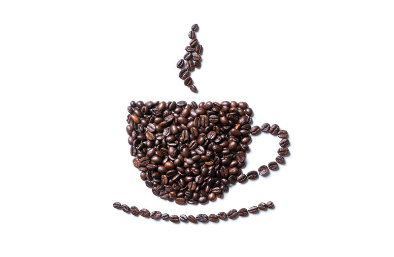 Close-up of coffee beans against white background