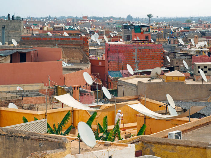 Architecture Building Building Exterior Built Structure City Cityscape Elevated View Parable Parabola Parabolic Antenna Residential Building Residential District Residential Structure Roof Roof Tile Rooftop Satellite Sky Town Tv Marrakech Marrakesh Morocco