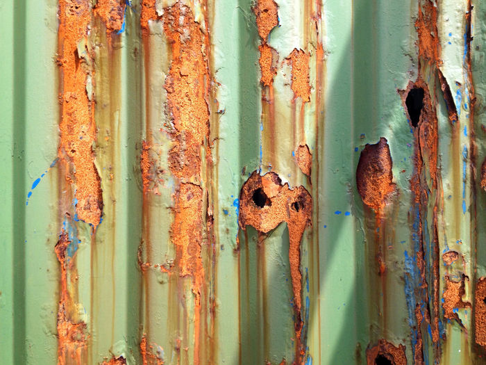 Full Frame Shot Of Peeled Off Rusty Corrugated Iron
