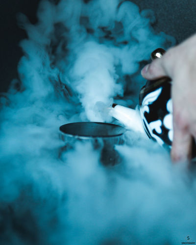 One Person Kitchen Utensil Human Hand Human Body Part Smoke - Physical Structure Hand Holding Food Real People Household Equipment Food And Drink Lifestyles Indoors  Eating Utensil Cooking Pan Spoon Preparation  Men Activity Preparing Food