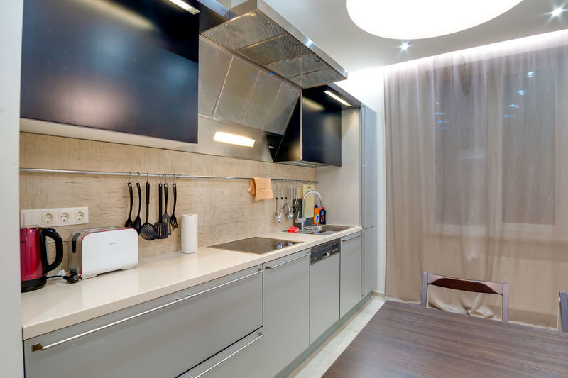Domestic Room Indoors  Home Modern Kitchen Home Interior Domestic Kitchen Home Showcase Interior No People Lighting Equipment Household Equipment Absence Appliance Illuminated Luxury White Color Wealth Furniture Seat Kitchen Counter Oven