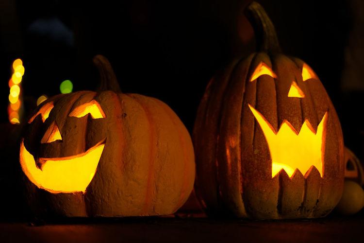 Close-up of pumpkin pumpkins against black background