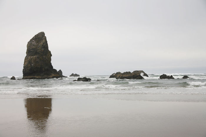 Cannon Beach Coastline Oregon Beauty Rock Rock Formation Beach Beachphotography Beauty In Nature Canon Beach Clear Sky Close-up Day Nature No People Oregon Coast Outdoors Rock - Object Scenics Sea Sky Tranquil Scene Tranquility Water