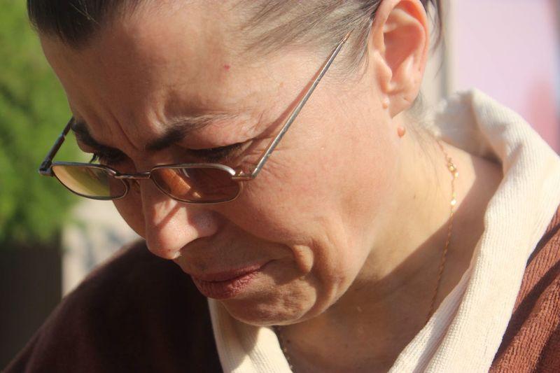 Close-up of mature woman wearing eyeglasses