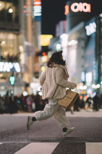 Built Structure City City Life Coen Crossing Focus On Foreground Japan Jumping Night One Person Outdoors Pedestrian Real People Running Shibuya Street Street Photography Street Portrait Streetphotography Streetportrait The Street Photographer - 2017 EyeEm Awards Walking