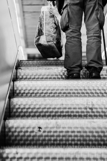 One Man Only One Person Only Men Standing People Indoors  Adult Men Human Body Part Day Alone Transportation Train Station Shopping Bags 50mm Blackandwhite Bnw Legs Trousers Legs_only Shoppingbag 50mm1.4 Depth Of Field Depth