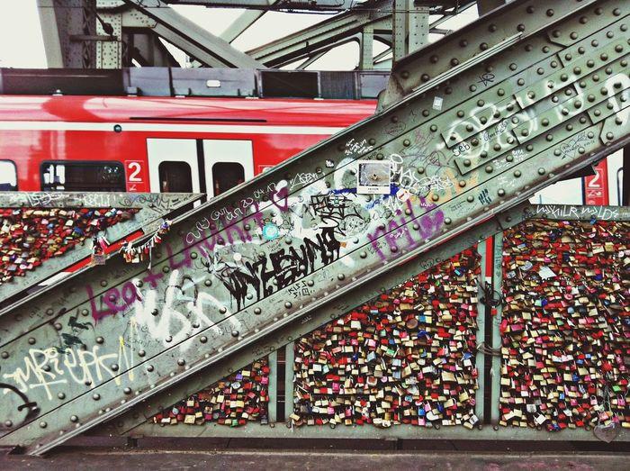 Close-up of graffiti on metallic beam