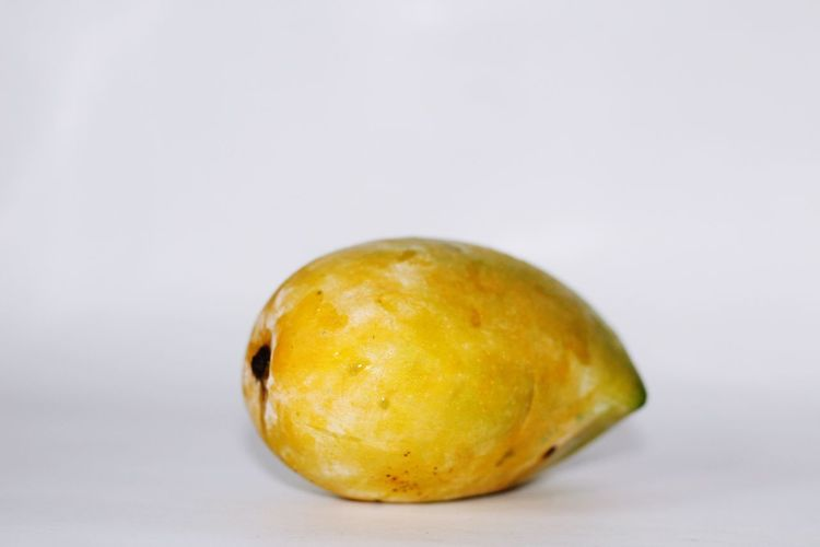 Food And Drink Fruit Food Healthy Eating Studio Shot White Background Freshness Citrus Fruit No People Close-up Yellow Mango Indoors  Day