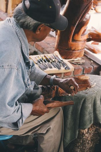 Adult Adults Only Casual Clothing Close-up Concentration Day Human Hand Indoors  Instrument Maker Jeans Men Occupation One Man Only One Person Only Men People Real People Shoemaker Sitting Skill  Small Business Work Tool Working Workshop