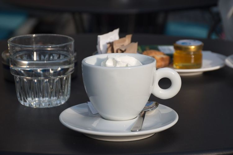 Mug Cup Coffee Cup Food And Drink Coffee Coffee - Drink Drink Refreshment Table Indoors  Still Life Close-up Freshness No People Focus On Foreground Spoon White Color Coffee Shop Teaspoon Glass Water Cream Black
