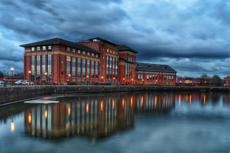 Another picture from last night, this is the Gateway building at Preston Marina. Reflection Water Cloud - Sky Architecture Illuminated Waterfront Preston Docks Reflection Nikon Stormy Weather Tranquility Malephotographerofthemonth Photography Is My Escape From Reality! Nikon Photography Atmospheric Mood Architecture