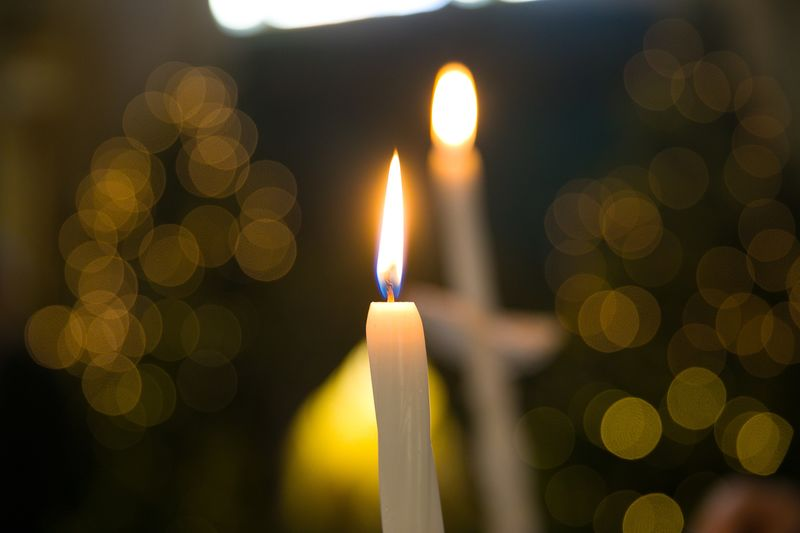 Close-up of burning candles
