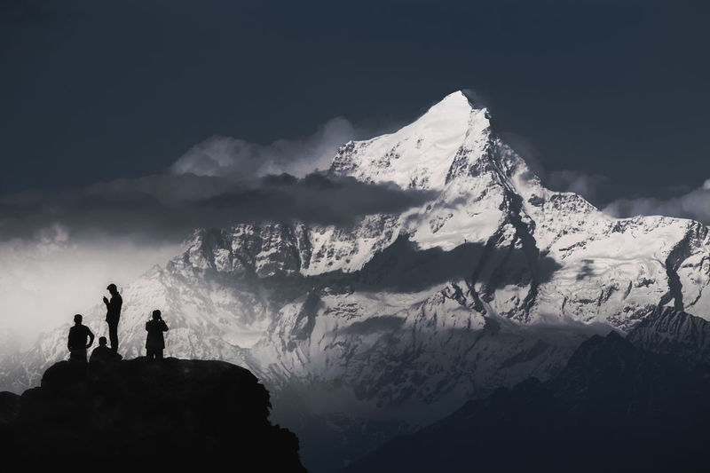 Mountain Snow Togetherness Adventure Hiking Silhouette Cliff Climbing Astronomy Mountain Peak Snowcapped Mountain Mountain Climbing Hiker Pursuit - Concept Physical Geography Free Climbing Natural Landmark Rocky Mountains Rock Formation Backpack Clambering Rock Climbing A New Beginning