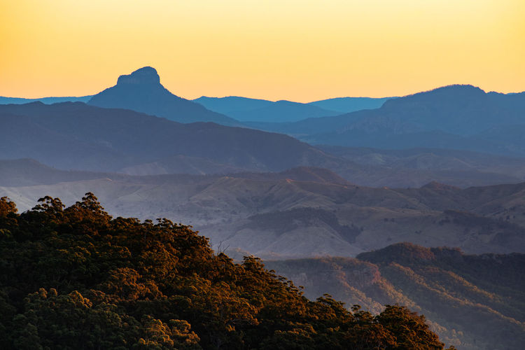 Scenic view of mount lindesay, queensland, australia against clear sky during sunset
