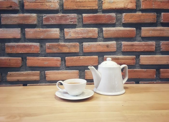 Tea Cupset Coffee Cup Coffee - Drink Food And Drink Brick Wall Saucer Drink Refreshment Indoors  Table No People Freshness Day