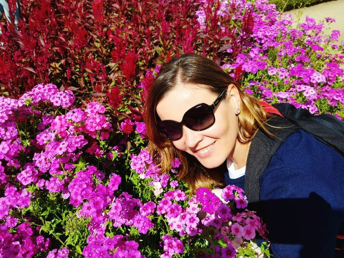 Sunglasses Flower Only Women One Person Outdoors Adult Day Beautiful Woman Smiling Young Women Women Adults Only One Woman Only Headshot Beauty People Nature Young Adult Happiness One Young Woman Only