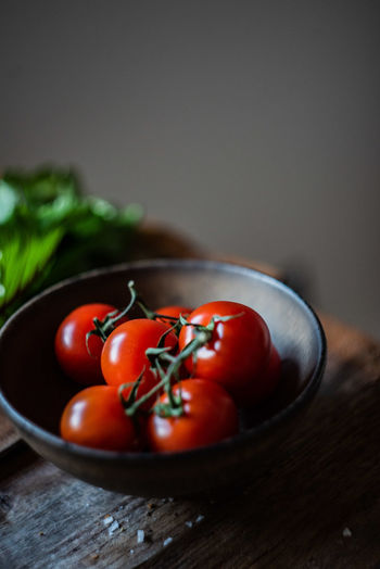 Close-up of tomatoes on cutting board