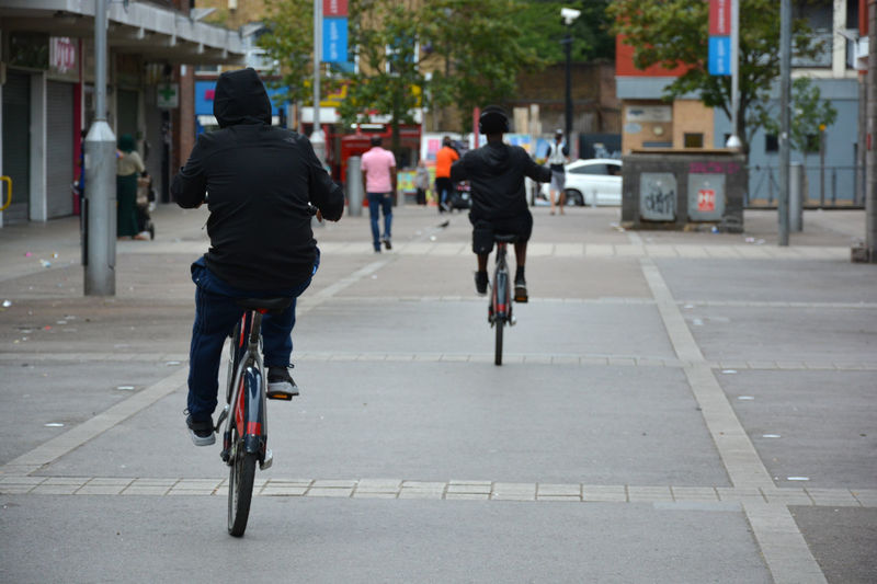 EAST LONDON VIBES Architecture Bike Casual Clothing City City Life City Street Cyling Day Full Length Leisure Activity Lifestyles Outdoors Road Street The Way Forward Two CyclingUnites