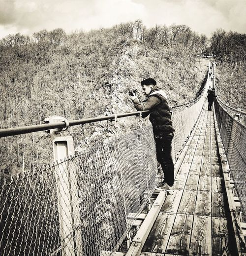 Real People Outdoors Germany Gierelay Suspension Bridge Thrillseeker Adventure Travel Europe Photography One Person Casual Clothing Tree Railing Day Leisure Activity Full Length Sky