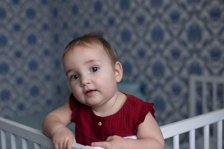 Portrait of cute baby boy looking away