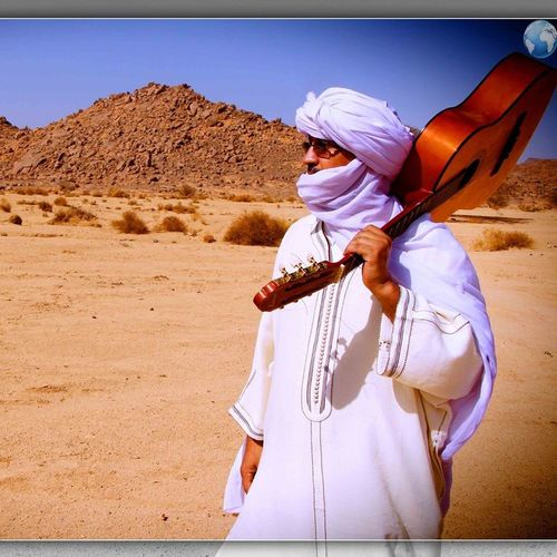 Traditional Clothing Desert Land Clothing Holding Playing Leisure Activity Sunlight Musical Instrument