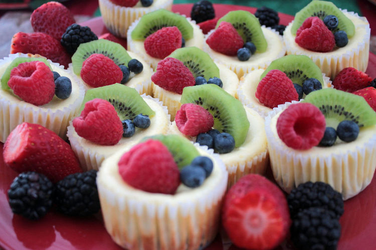 High angle view of small cheesecakes with fruits