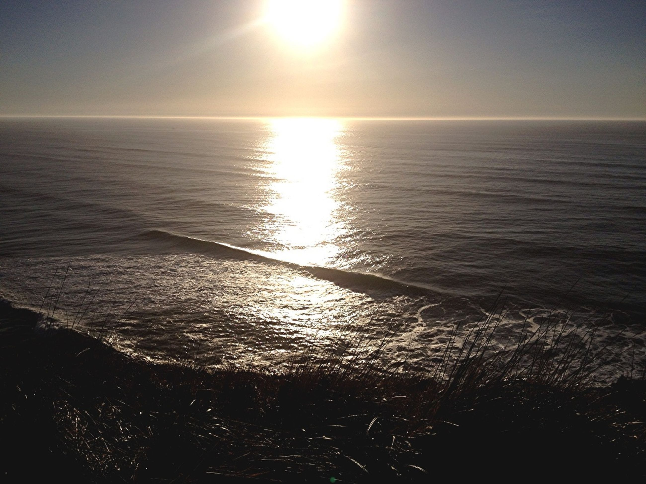 sea, water, horizon over water, tranquil scene, scenics, tranquility, sun, beauty in nature, sunset, reflection, nature, idyllic, sky, seascape, sunlight, rippled, clear sky, beach, calm, outdoors