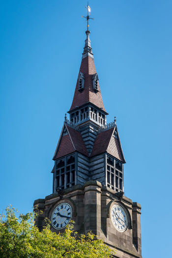Tower of Derby Museum and Library Derby Architecture Bell Tower Blue Building Exterior Built Structure Clear Sky Clock Clock Face Clock Tower Day History Low Angle View Minute Hand Nature No People Outdoors Sky Spirituality Time Tower Travel Destinations Tree