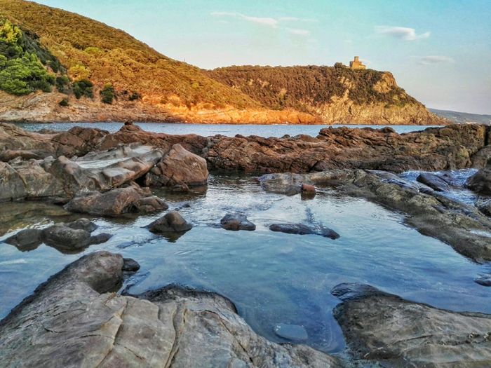 Rock - Object Nature Outdoors Water Landscape Scenics Beauty In Nature Mountain Day No People Sky Sea And Sky Sea Rock Formation Rocks Water Reflections Beauty In Nature Beach Summer Sea View Rocks And Water Nature Rocce Scogli Mare The Great Outdoors - 2017 EyeEm Awards