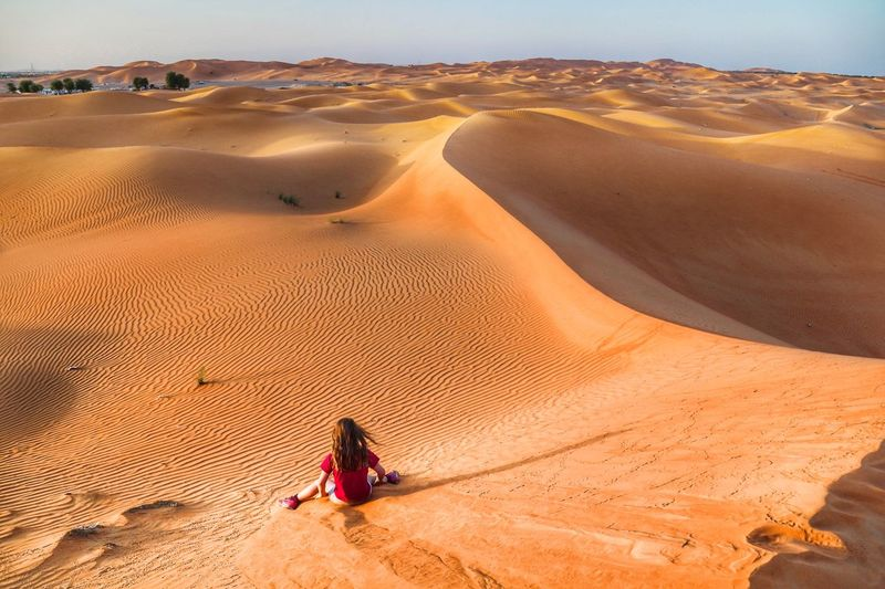 Lonely in the desert Land Sand Desert Landscape Sand Dune One Person Environment Nature Climate Women Beauty In Nature Arid Climate Scenics - Nature Lifestyles Remote Outdoors Travel Tranquility