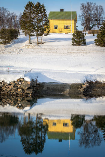 Architecture Bare Tree Building Exterior Built Structure Cold Temperature Covering Day Fjord Fjords Frozen House Nature Northern Norway Norway Outdoors Reflection River Season  Sky Snow Tree Water Water Reflections Winter Yellow House