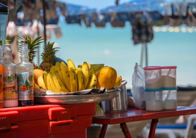 Beach food at Pattaya Beach Thailand Beach Life Pataya Beach Thailand Banana Beach Beach Food Close-up Day Drink Focus On Foreground Food Food And Drink Freshness Fruit Healthy Eating Liesure No People Outdoors Pataya Relaxig Sun Light Table Vacation Water Waterfront