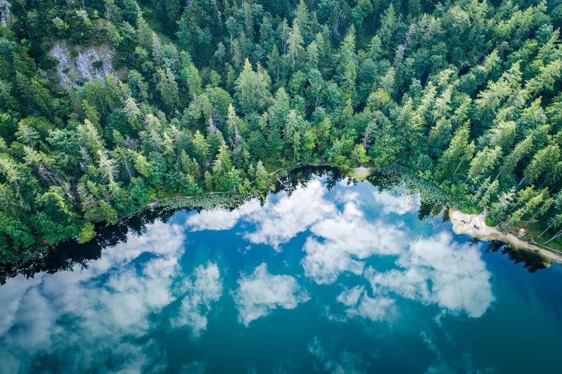 Aerial view at lake eibensee, a beautiful small mountain lake in the austrian alps near salzburg.